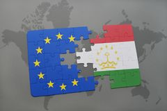 Puzzle with the national flag of tajikistan and european union on a world map Stock Photography