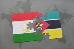 Puzzle with the national flag of tajikistan and mozambique on a world map. Background. 3D illustration Royalty Free Stock Images