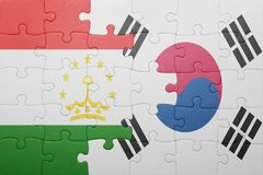 Puzzle with the national flag of tajikistan and south korea. Concept royalty free stock images