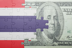 Puzzle with the national flag of thailand and dollar banknote Royalty Free Stock Photo