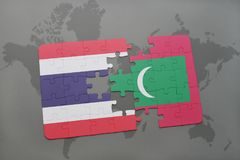 Puzzle with the national flag of thailand and maldives on a world map background. Royalty Free Stock Image