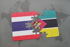 Puzzle with the national flag of thailand and mozambique on a world map Royalty Free Stock Photo