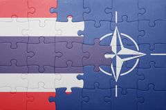 Puzzle with the national flag of thailand and nato. Concept royalty free stock photo