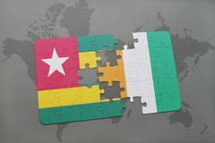 Puzzle with the national flag of togo and cote divoire on a world map. Background. 3D illustration Royalty Free Stock Photography