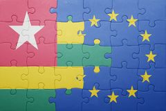 Puzzle with the national flag of togo and european union Stock Images