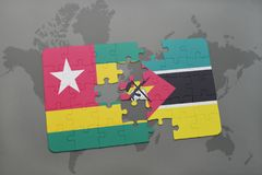 Puzzle with the national flag of togo and mozambique on a world map. Background. 3D illustration Royalty Free Stock Image