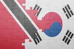 Puzzle with the national flag of trinidad and south korea. Concept stock photo