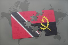 Puzzle with the national flag of trinidad and tobago and angola on a world map. Background. 3D illustration Royalty Free Stock Images
