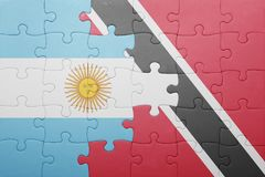 Puzzle with the national flag of trinidad and tobago and argentina Royalty Free Stock Photography