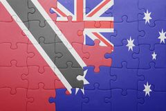 Puzzle with the national flag of trinidad and tobago and  australia Royalty Free Stock Photo