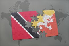 Puzzle with the national flag of trinidad and tobago and bhutan on a world map Stock Photography