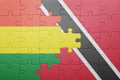 Puzzle with the national flag of trinidad and tobago and bolivia Royalty Free Stock Image