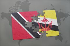 Puzzle with the national flag of trinidad and tobago and brunei on a world map Stock Images