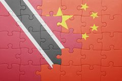 Puzzle with the national flag of trinidad and tobago and china Royalty Free Stock Image
