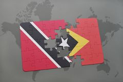 Puzzle with the national flag of trinidad and tobago and east timor on a world map. Background. 3D illustration Stock Image