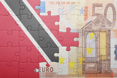 Puzzle with the national flag of trinidad and tobago and euro banknote Stock Photos