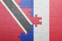 Puzzle with the national flag of trinidad and tobago and france Stock Images