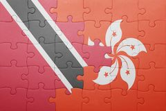 Puzzle with the national flag of trinidad and tobago and hong kong Stock Photo