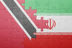 Puzzle with the national flag of trinidad and tobago and iran Stock Photo