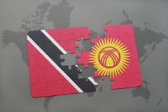 Puzzle with the national flag of trinidad and tobago and kyrgyzstan on a world map Stock Photos