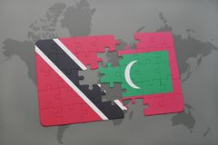 Puzzle with the national flag of trinidad and tobago and maldives on a world map. Background. 3D illustration Royalty Free Stock Image