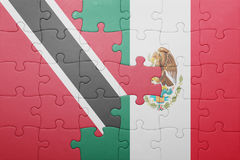 Puzzle with the national flag of trinidad and tobago and mexico. Concept royalty free stock photos