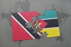 Puzzle with the national flag of trinidad and tobago and mozambique on a world map. Background. 3D illustration Royalty Free Stock Photography