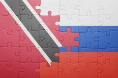 Puzzle with the national flag of trinidad and tobago and russia Stock Photo