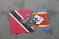 Puzzle with the national flag of trinidad and tobago and swaziland on a world map Stock Photo
