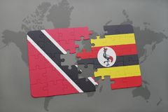 Puzzle with the national flag of trinidad and tobago and uganda on a world map. Background. 3D illustration Stock Image