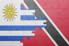 Puzzle with the national flag of trinidad and tobago and uruguay Royalty Free Stock Photos