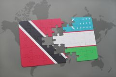 Puzzle with the national flag of trinidad and tobago and uzbekistan on a world map Stock Photo