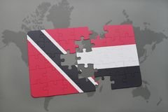 Puzzle with the national flag of trinidad and tobago and yemen on a world map. Background. 3D illustration Stock Photo