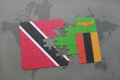 Puzzle with the national flag of trinidad and tobago and zambia on a world map. Background. 3D illustration Stock Photo