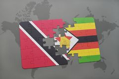 Puzzle with the national flag of trinidad and tobago and zimbabwe on a world map. Background. 3D illustration Royalty Free Stock Photos