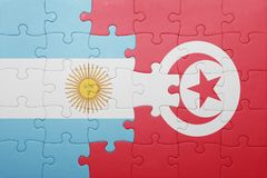 Puzzle with the national flag of tunisia and argentina Royalty Free Stock Photography