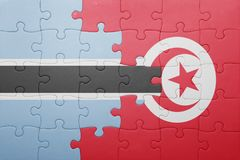 Puzzle with the national flag of tunisia and botswana Stock Photos