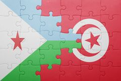 Puzzle with the national flag of tunisia and djibouti Royalty Free Stock Photography