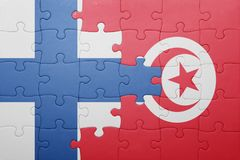 Puzzle with the national flag of tunisia and finland Royalty Free Stock Photos
