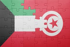 Puzzle with the national flag of tunisia and kuwait. Concept Stock Photography
