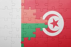 Puzzle with the national flag of tunisia and madagascar. Concept Royalty Free Stock Photo