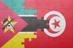 Puzzle with the national flag of tunisia and mozambique Stock Image