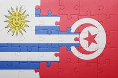 Puzzle with the national flag of tunisia and uruguay. Concept Stock Photo