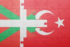 Puzzle with the national flag of turkey and Basque Country. Concept stock image