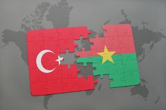 Puzzle with the national flag of turkey and burkina faso on a world map. Background. 3D illustration stock photography