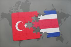 Puzzle with the national flag of turkey and costa rica on a world map. Background. 3D illustration royalty free stock photography