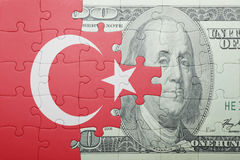 Puzzle with the national flag of turkey and dollar banknote. Concept stock photo