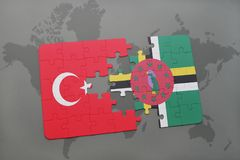 Puzzle with the national flag of turkey and dominica on a world map. Background. 3D illustration royalty free stock image