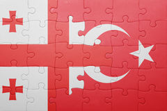 Puzzle with the national flag of turkey and georgia. Concept Stock Images