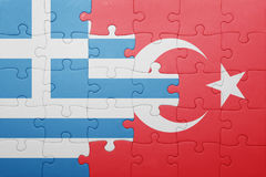 Puzzle with the national flag of turkey and greece. Concept royalty free stock photography